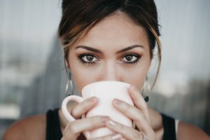 woman drinking cold brew coffee
